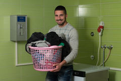 Young Man Doing Housework Laundry Stock Photo