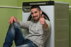 Young Man Doing Housework Laundry Thumbs Up Sign Stock Photos
