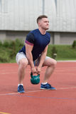 Young Man Doing Kettle Bell Exercise Outdoor Royalty Free Stock Images