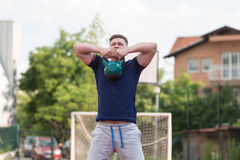 Young Man Doing Kettle Bell Exercise Outdoor Stock Photos