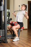 Young man doing lats pull-down workout in gym Royalty Free Stock Photography