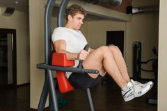 Young man doing lats pull-down workout Stock Image