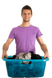 Young man doing the laundry. Young man doing the washing Stock Photos