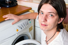 Young man doing laundry at home Royalty Free Stock Images