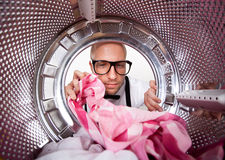 Young man doing laundry Stock Photo