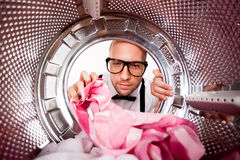 Young man doing laundry Royalty Free Stock Photos