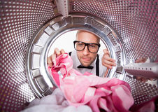 Young man doing laundry Stock Photography