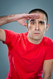 Young Man Doing a Militar Salute Stock Images