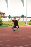 Young Man Doing A Overhead Squat Exercise Outdoor Stock Image