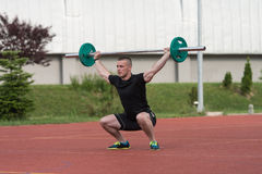 Young Man Doing A Overhead Squat Exercise Outdoor Royalty Free Stock Images