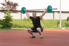 Young Man Doing A Overhead Squat Exercise Outdoor Stock Photos