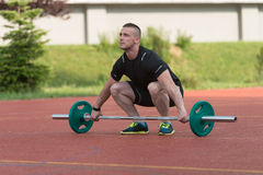 Young Man Doing A Overhead Squat Exercise Outdoor Royalty Free Stock Photo