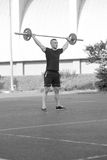 Young Man Doing A Overhead Squat Exercise Outdoor Royalty Free Stock Photos