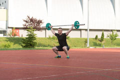 Young Man Doing A Overhead Squat Exercise Outdoor Royalty Free Stock Photography
