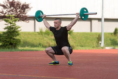 Young Man Doing A Overhead Squat Exercise Outdoor Stock Images