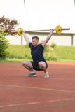 Young Man Doing A Overhead Squat Exercise Outdoor Stock Photo