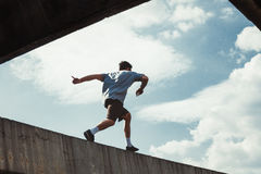 Young man doing parkour in the city Stock Image