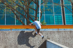 Young man doing parkour in the city Stock Photos