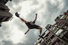 Young man doing parkour jump  in the city Stock Photos