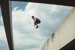 Young man doing parkour jump  in the city Stock Photography