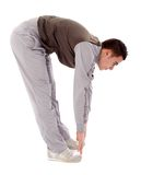 Young man doing physical exercises Stock Photos