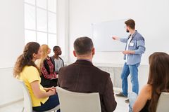 Young man doing presentation in office copy space stock image