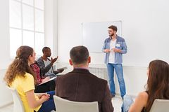Young man doing presentation in office copy space. Young men doing presentation in office, copy space. Startup business meeting, sharing new ideas to partners royalty free stock images
