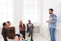 Young man doing presentation in office copy space. Young men doing presentation in office, copy space. Startup business meeting, sharing new ideas to partners royalty free stock photos