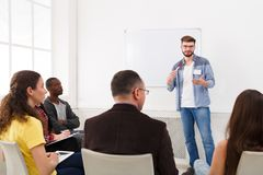 Young man doing presentation in office copy space. Young men doing presentation in office, copy space. Startup business meeting, sharing new ideas to partners stock photo