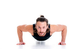 Young man doing press-up Stock Photo