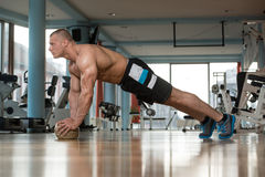 Young Man Doing Press Ups On Fitness Ball Royalty Free Stock Photography