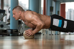 Young Man Doing Press Ups On Fitness Ball Stock Images