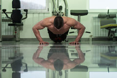 Young Man Doing Press Ups In Gym Stock Image