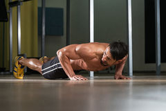 Young Man Doing Press Ups In Gym Stock Photo