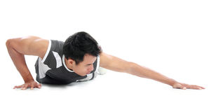 Young man doing push up exercise. Portrait of Young  fitness man doing push ups on floor Royalty Free Stock Images