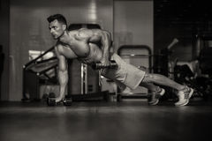 Young Man Doing Push Ups With Dumbbells On Floor Stock Images