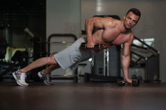 Young Man Doing Push Ups With Dumbbells On Floor Stock Photos