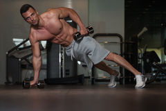 Young Man Doing Push Ups With Dumbbells On Floor Royalty Free Stock Images