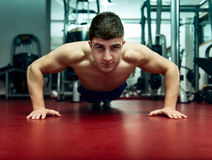 Young man doing push ups at the gym Royalty Free Stock Image