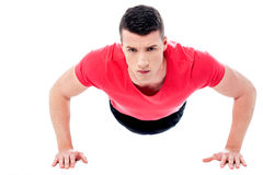 Young man doing push-ups Stock Photos