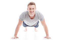 Young man doing push ups Stock Photography