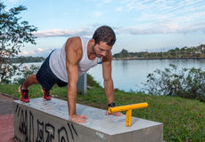 Young Man Doing Push Ups. Young Man Working Out Outdoors Doing Push Ups Stock Photo