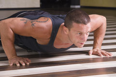 Young man doing pushups Stock Images