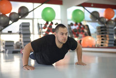 Young Man Doing Pushups at gym Stock Image