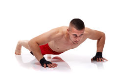 Young man doing pushups Stock Photos
