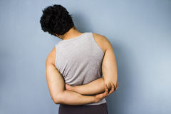 Young man doing side stretch. Young multiracial man stretching his back Royalty Free Stock Photos