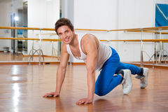 Young man doing sit ups in the fitness studio Stock Image
