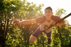 Young man doing slack line Royalty Free Stock Image