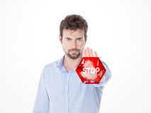 Young man doing stop gesture with his hand Royalty Free Stock Images