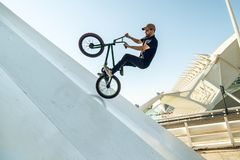 Young man doing street tricks with a bmx. Extreme urban sports concept stock photos